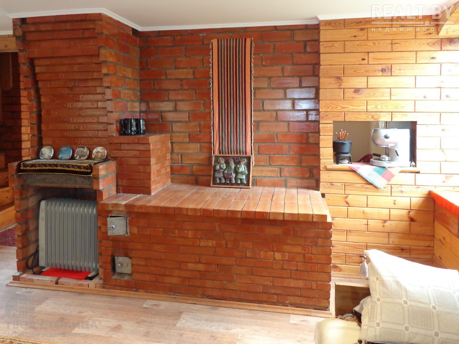 Печь в интерьере загородного деревянного дома: фото варианты