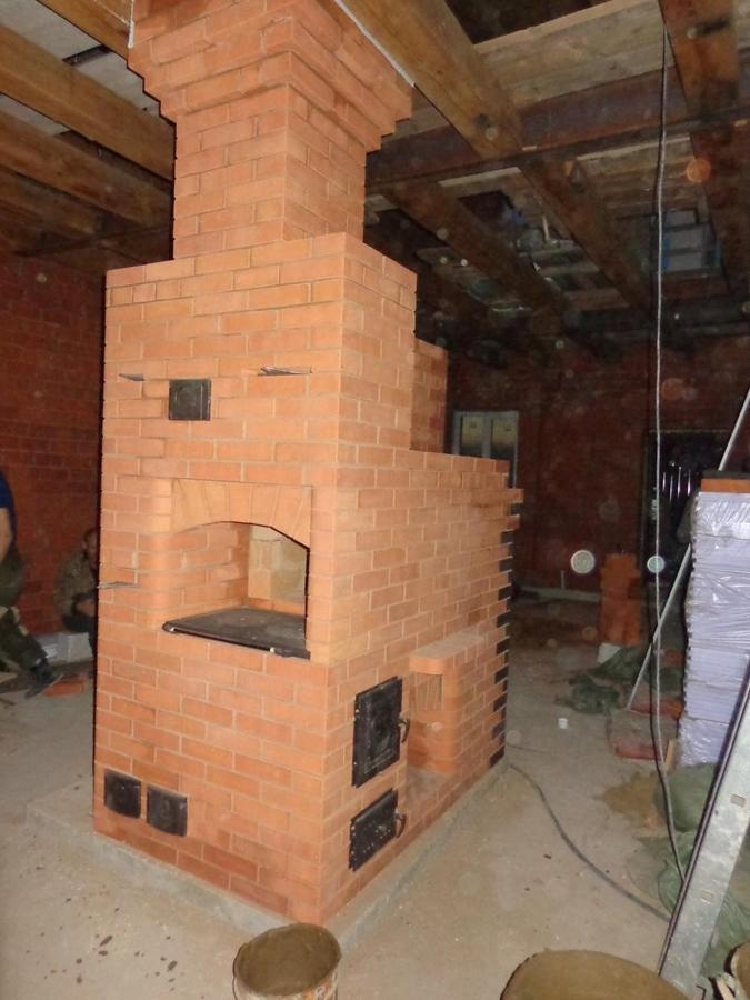 Русская печь в интерьере современного деревянного дома