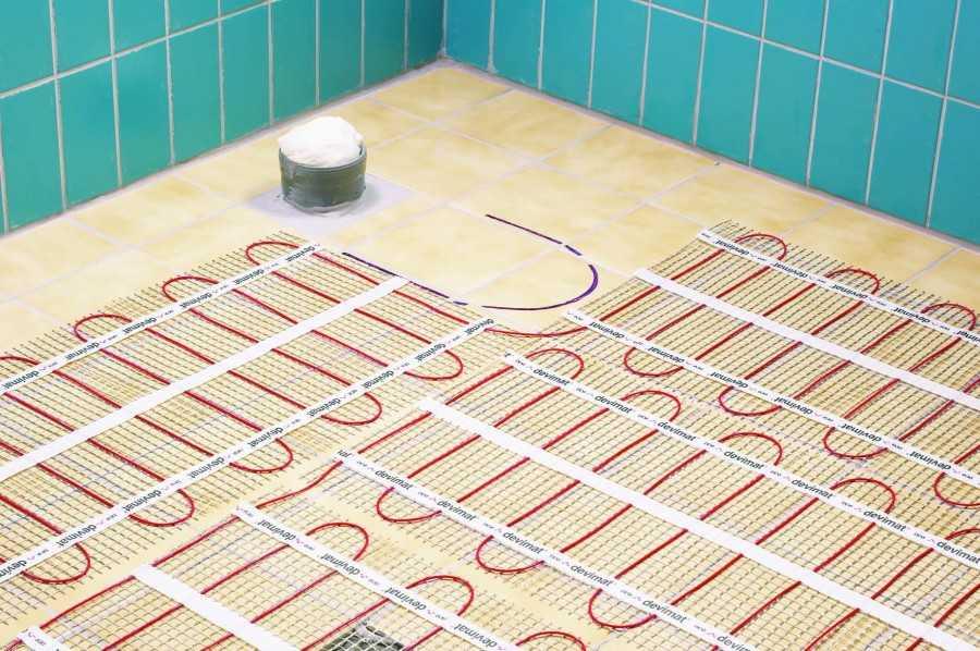 Как сделать теплый пол под плитку: правила укладки + руководство по установке