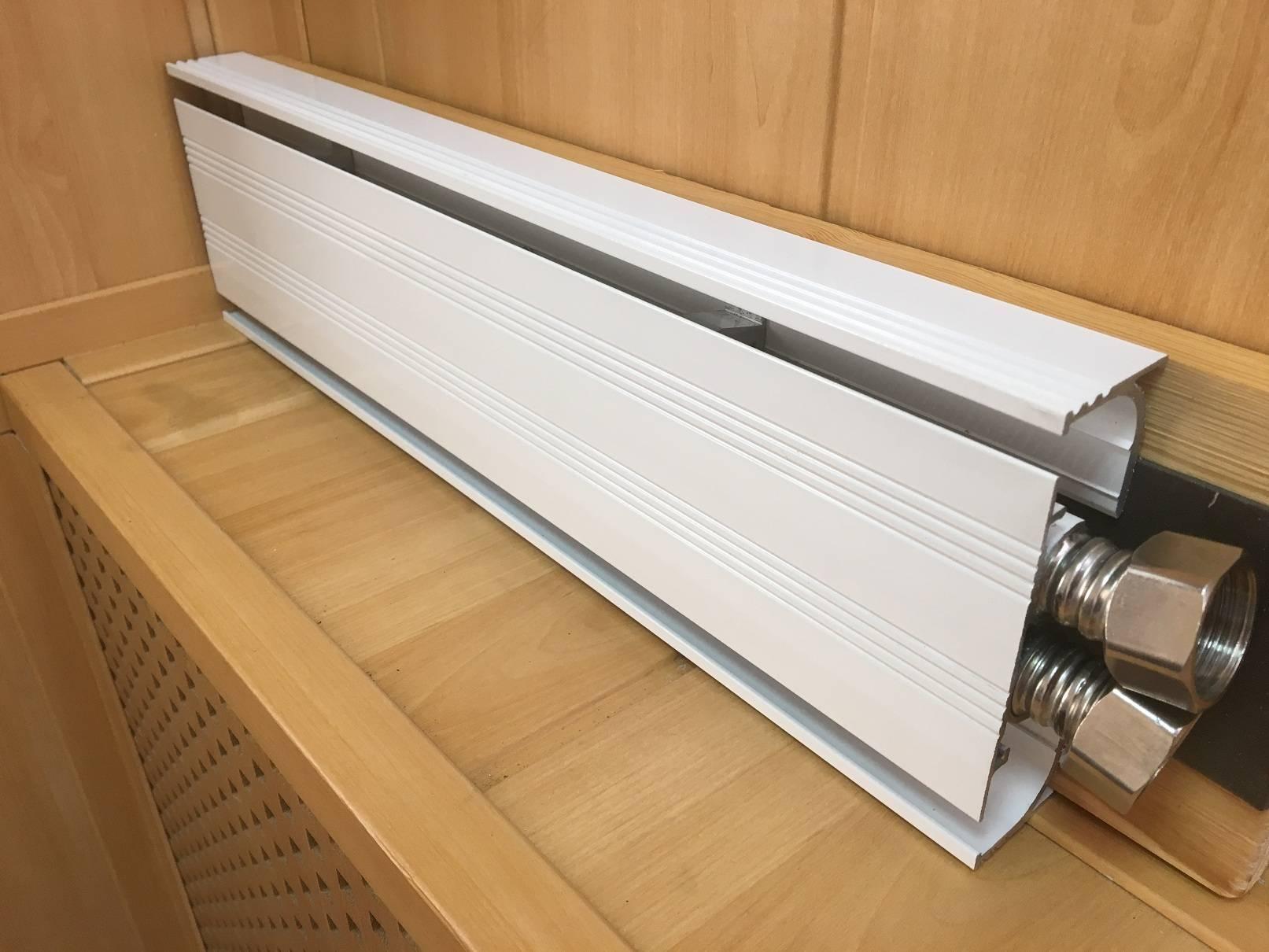 Электрическая и водяная система плинтусного отопления
