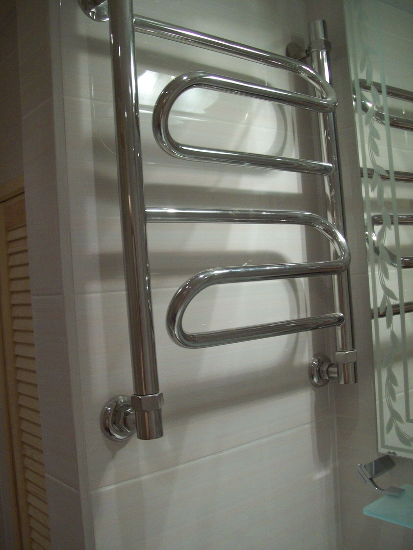 Как сделать перенос полотенцесушителя на другую стену и что для этого нужно учесть?