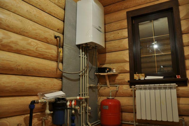 Отопление загородного дома разными вариантами котлов: твердотопливные, жидкотопливные, электрические, газовые