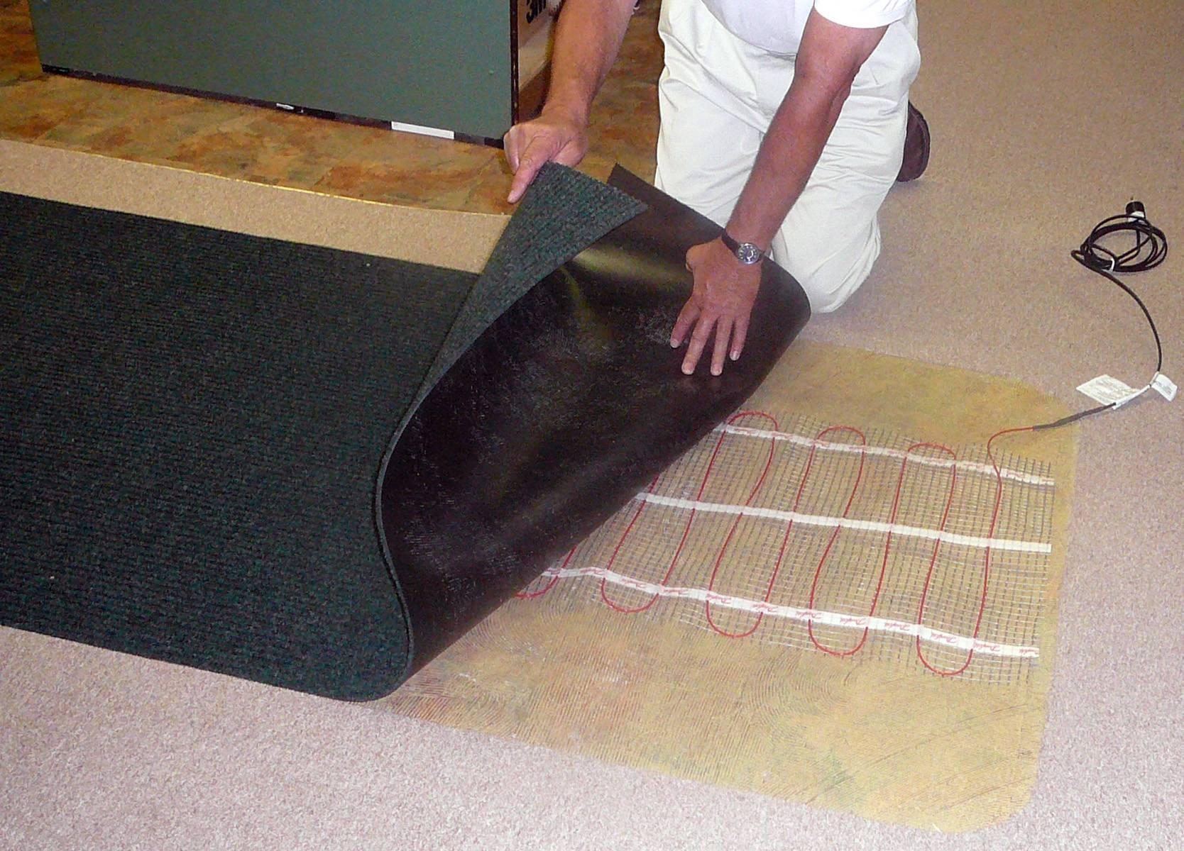 Теплый пол под ковролин — выбор и монтаж системы отопления