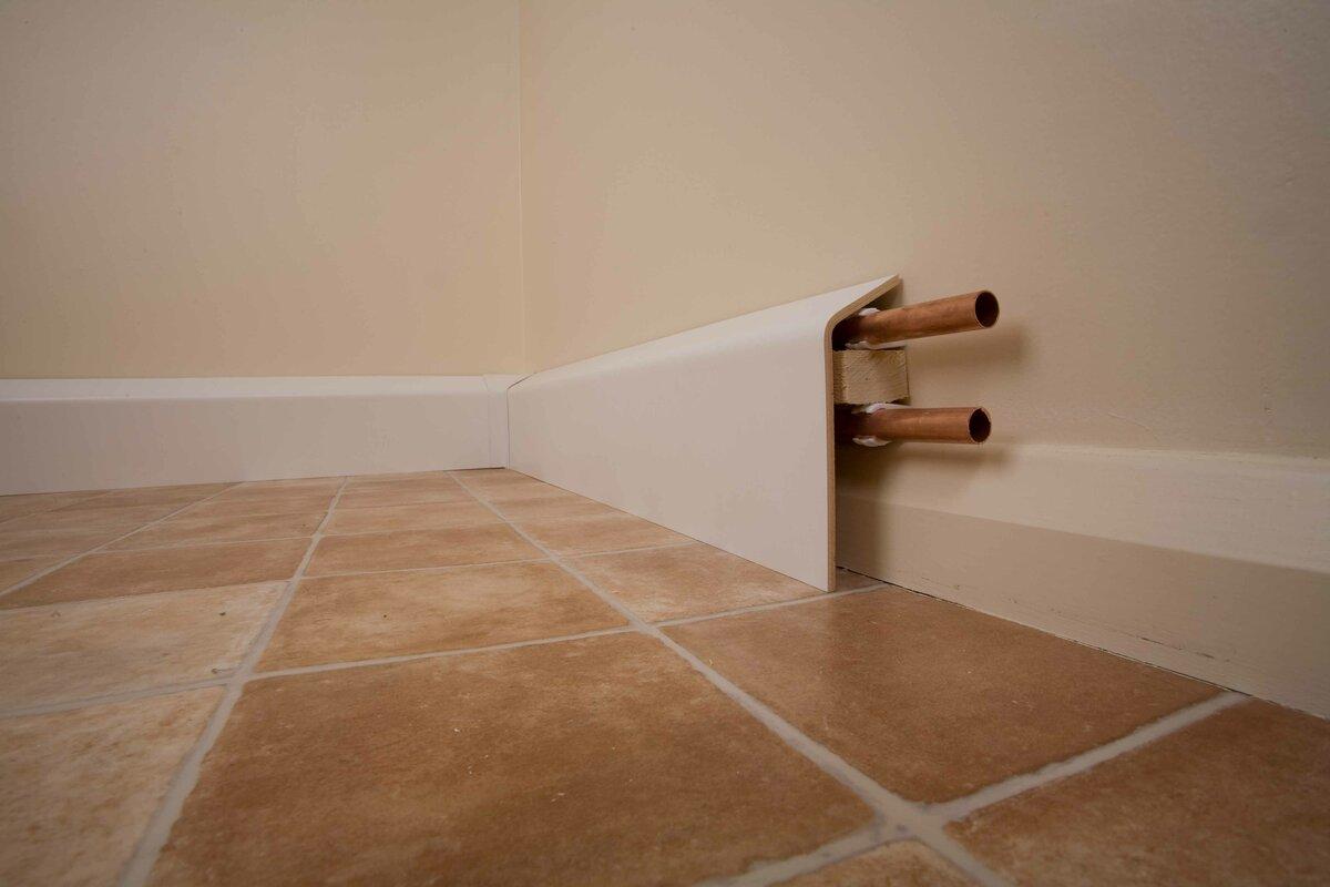 Как скрыть трубы отопления в квартире