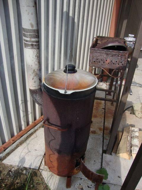 Как сделать печку из 200-литровой бочки своими руками