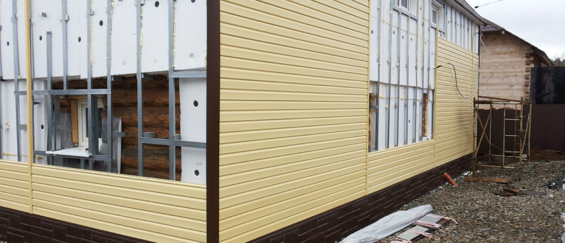 Утепление брусового дома снаружи под сайдинг и обшивка панелями своими руками
