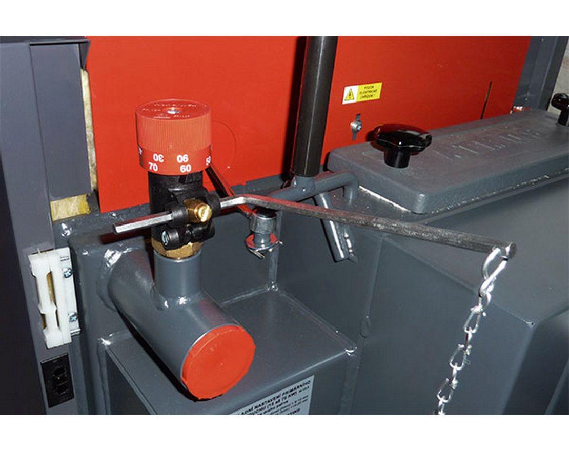 Устройство и монтаж регулятора тяги для твердотопливных котлов